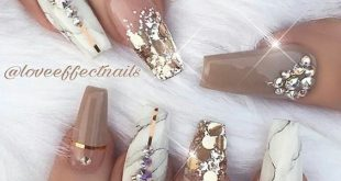 Surprisingly at first glance, the golden manicure is not on a ...