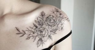 Tattoo shoulder, black tattoo with flowers.