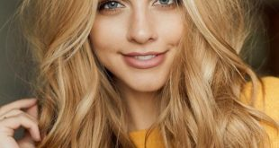 long blonde hair with natural curly hair, day make-up, delicate lipstick and ...