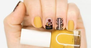 A dainty design with bold warm colours to contrast makes these nails by  perfect