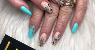 Beautiful teal color nails design with flowers