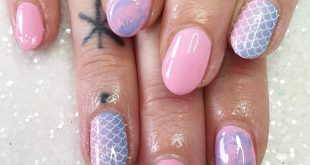 Blue, pink and iridescent glitter make the perfect combination for mermaid nails