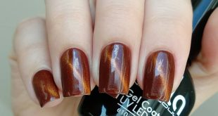Amber with the sky reflected in it in shade No. 606)) Magnetic gel polish, here