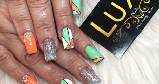 Fun to play with colors  bright green and orange nails