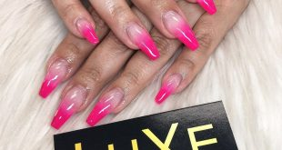 In  with this hot pink ombré coffin  nails