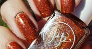 Another  this is Mystery Holo Cinq  with topcoat  Perfect burnt orange holo.