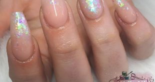 Rainbow flakes encapsulated in nails! What more could you ask for? Created by ou