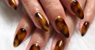 Tortoise shell nails by Larissa on natural nails using  'jet black' for the blob