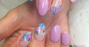 Beautiful pastel flower nails hand drawn by me using Halo powder blue and orchid