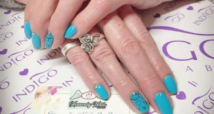 Blue/ turquoise gel polish (shellac) nails with freehand painted  dream catchers