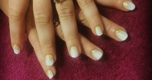 Just a simple gold & white gel manicure I did back in April for a clients prom n