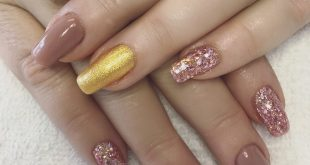 Similar to the set I posted the other day - only with a gold shimmer accent nail