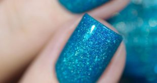 Maldives. 2 coats plus top coat.  Very beautiful and bright blue with a cool cr